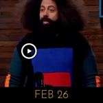 Image of Reggie Watts wearing a sweater with a red rectangle on it, on Comedy Bang! Bang!