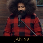 Image of Reggie Watts wearing a red buffalo check sweater on Comedy Bang! Bang!