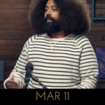Image of Reggie Watts wearing a pastel striped sweater on Comedy Bang! Bang!