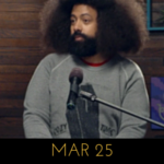 Image of Reggie Watts wearing a cozy time coffin sweater on Comedy Bang! Bang!