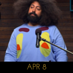 Image of Reggie Watts wearing a sweater that looks like Plankton from SpongeBob SquarePants, if he were blue, on Comedy Bang! Bang!