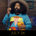 Image of Reggie Watts wearing a fake vest sweater on Comedy Bang! Bang!